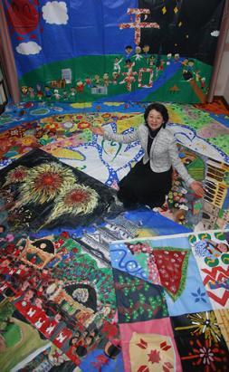 Atsuko surrounded by Art Miles Murals (JAM)